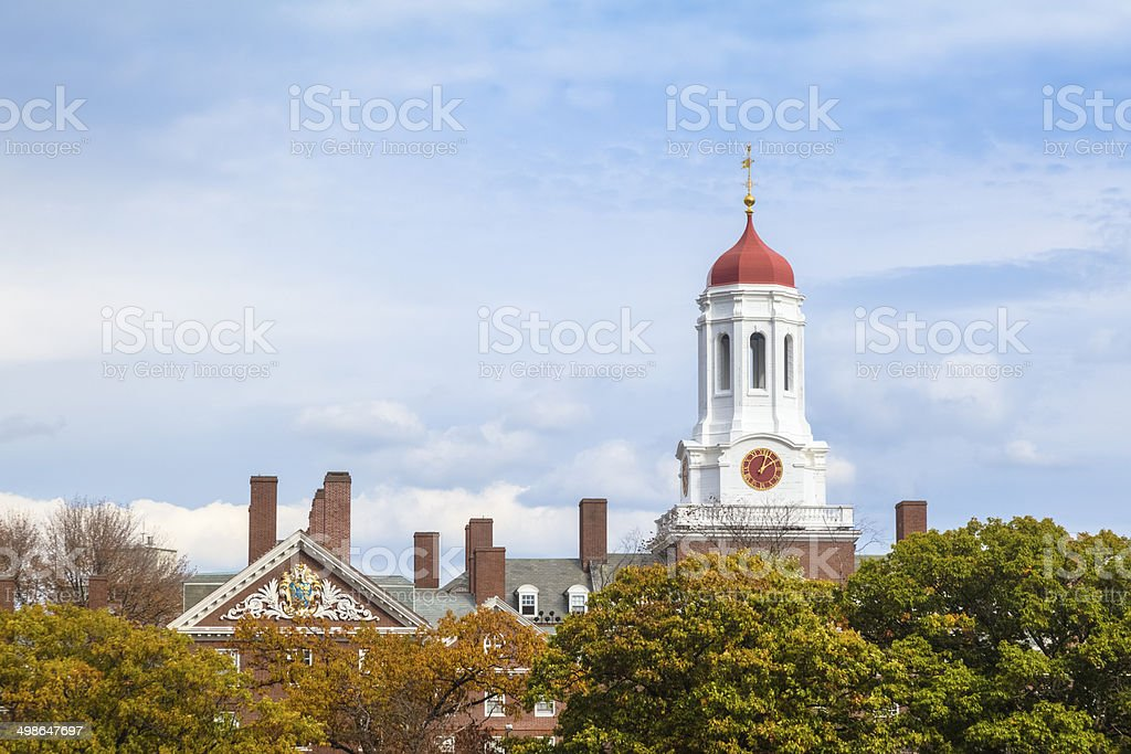 Harvard University's Dunster House Central Tower Rises Above Autumn Foliage stock photo