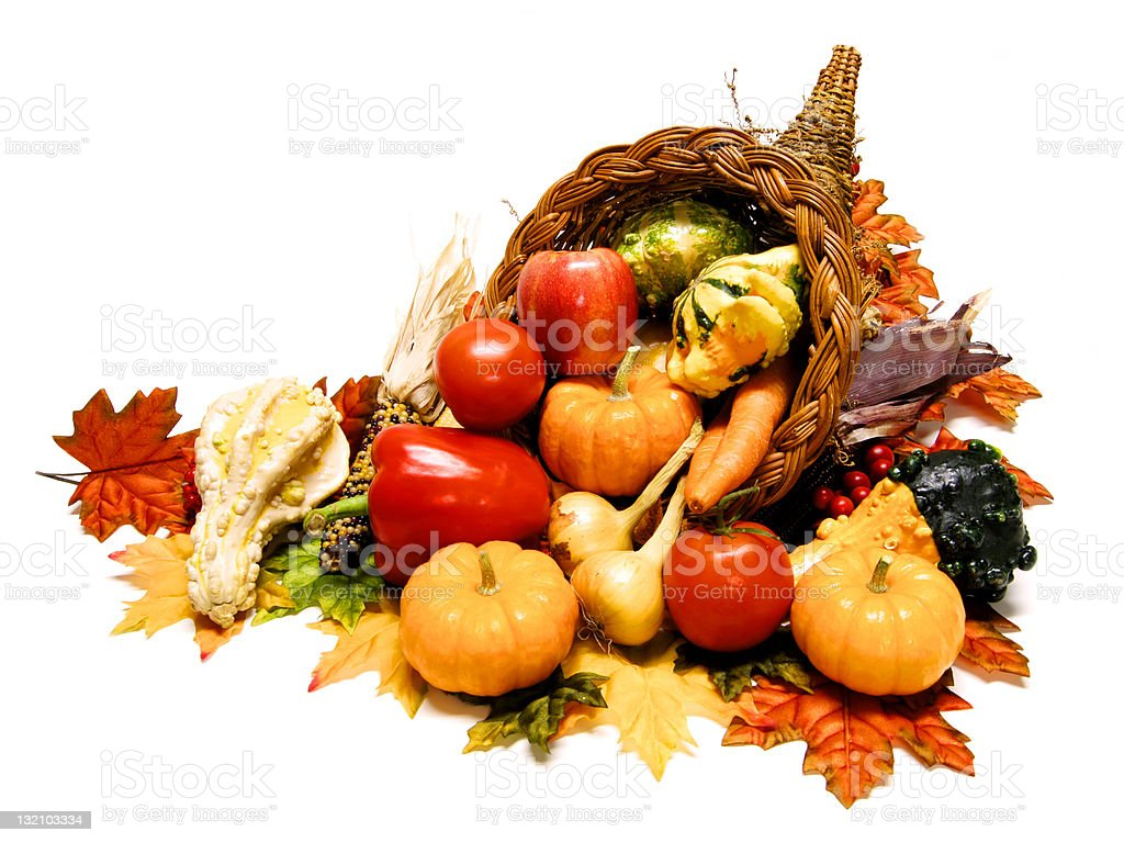 Harvest Cornucopia filled with vegetables over white stock photo