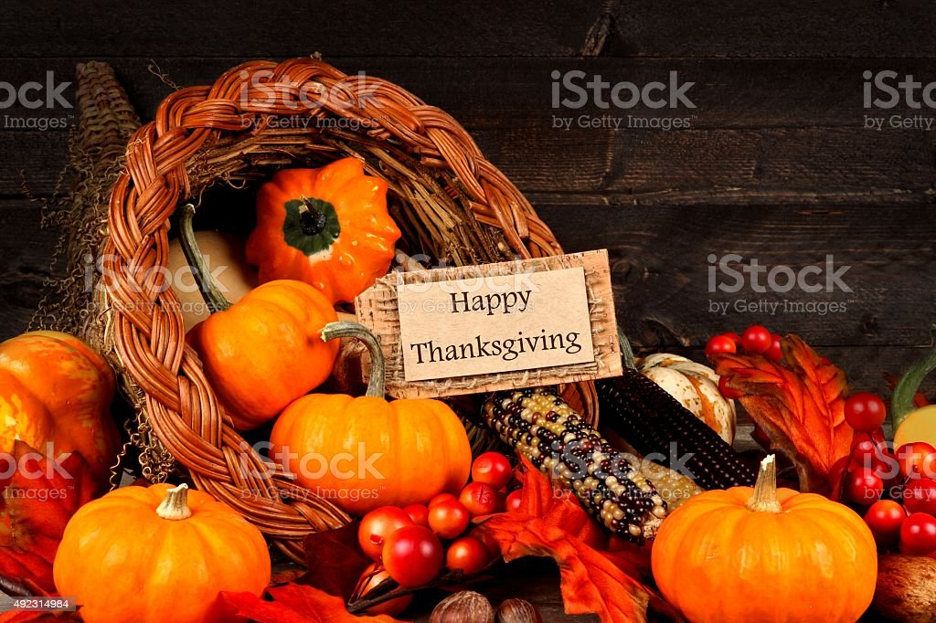 Harvest cornucopia with Happy Thanksgiving gift tag stock photo