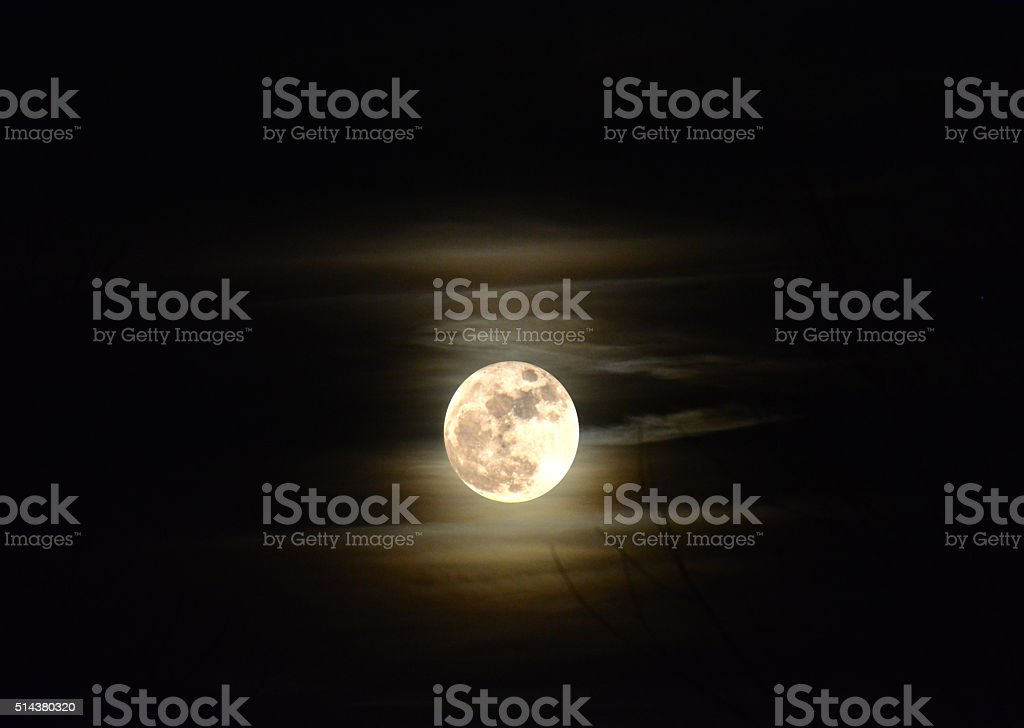 Harvest Full Moon in haze cloud color stock photo