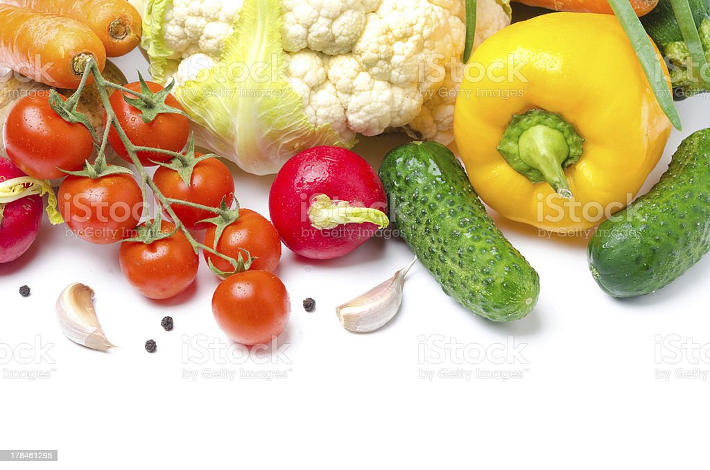 harvest of seasonal vegetables on a white background royalty-free stock photo