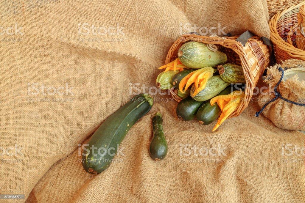 Harvest of zucchini, still life on jute stock photo
