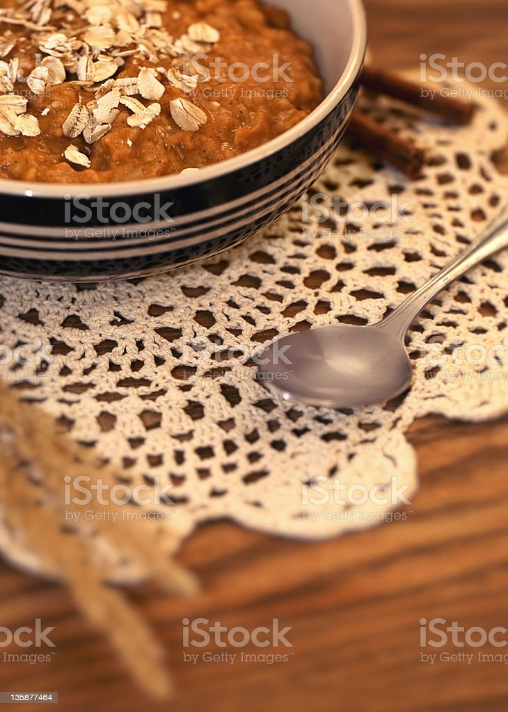 Harvest Pumpkin Oatmeal on Lace royalty-free stock photo