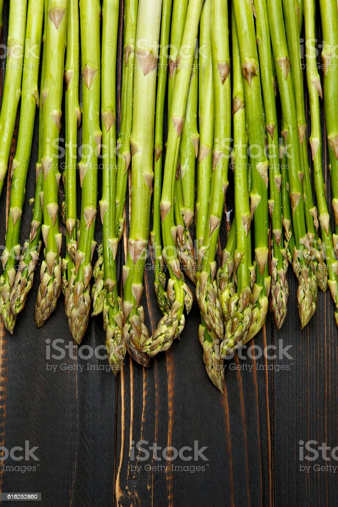 harvested asparagus on wooden stock photo