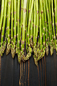 harvested asparagus on wooden