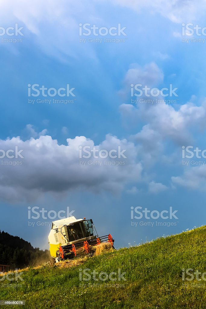 Harvester and clouds stock photo