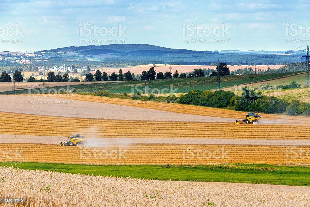 harvester machine on field stock photo