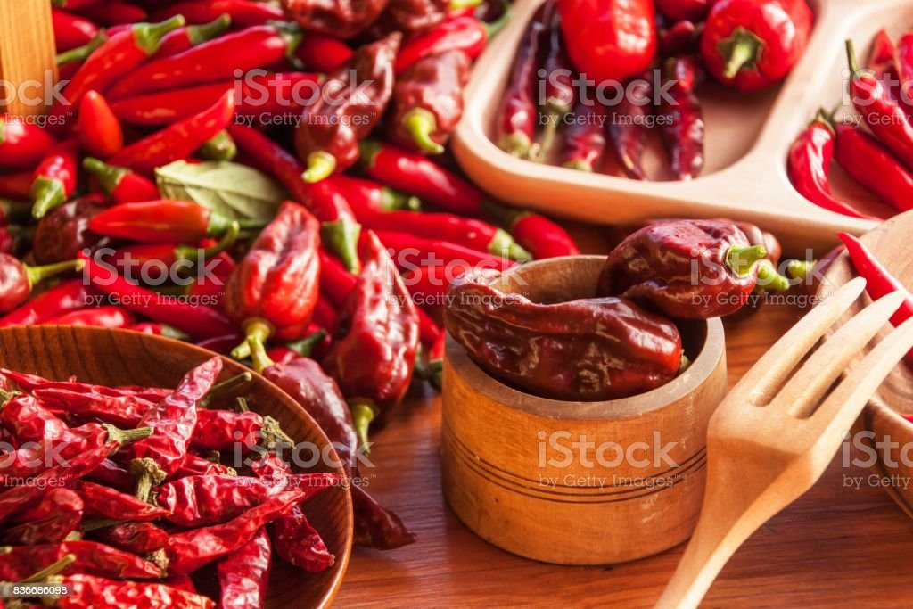 Harvesting chilli peppers. Preparing for drying spicy seasoning. Sale of spices. stock photo