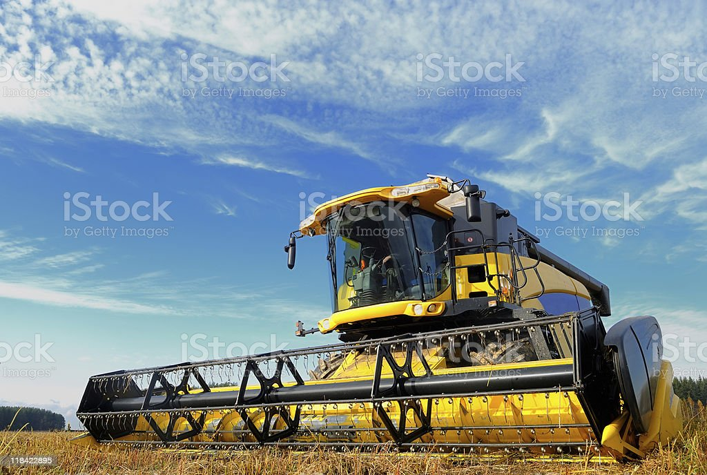 harvesting combine in the field royalty-free stock photo