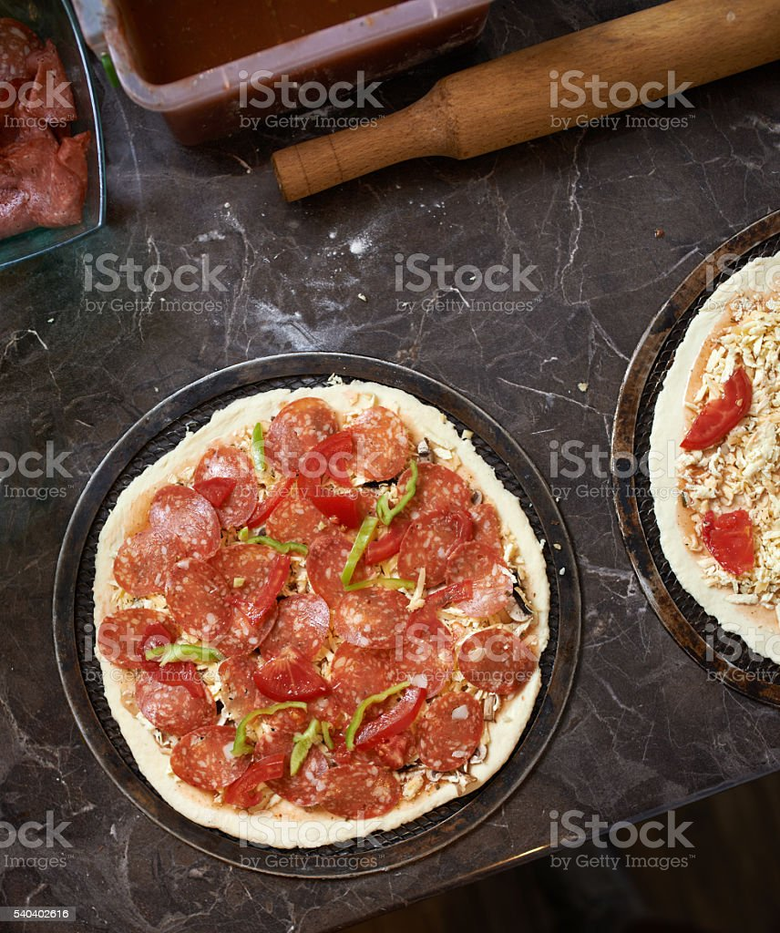 harvesting pizza with bacon on  table stock photo