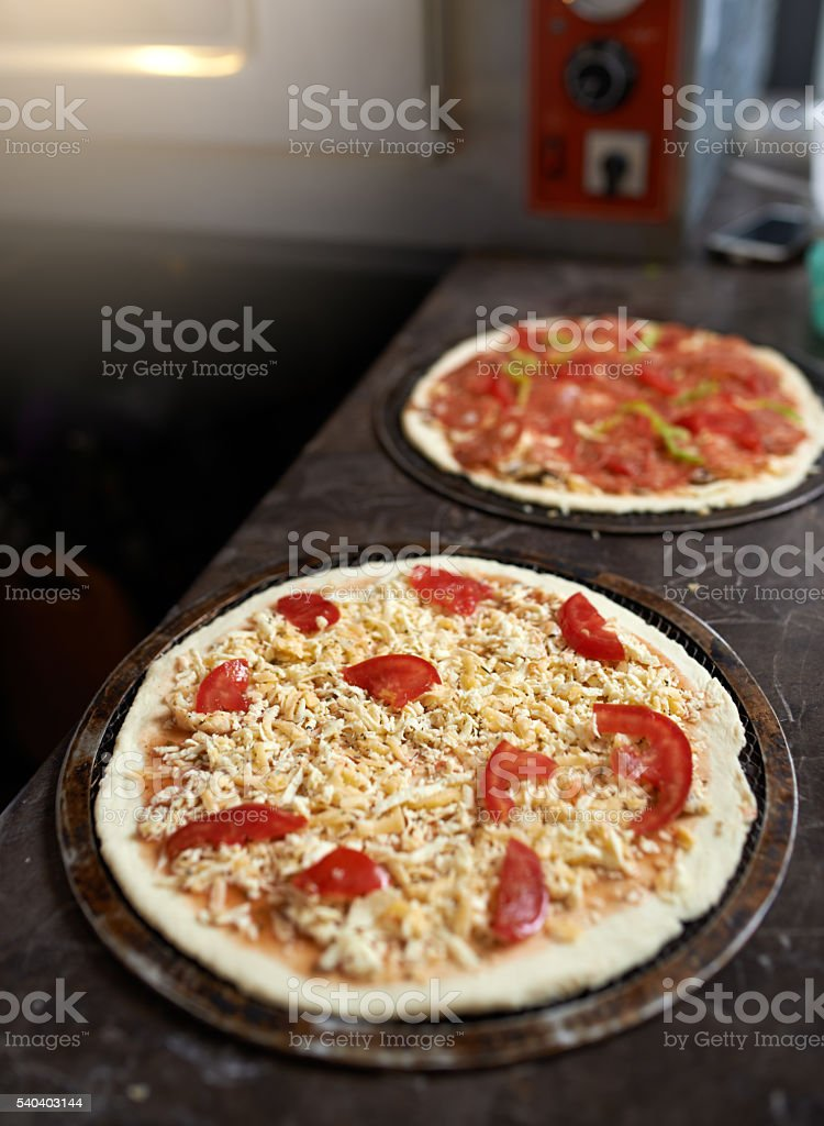 harvesting pizza with cheese on  table stock photo