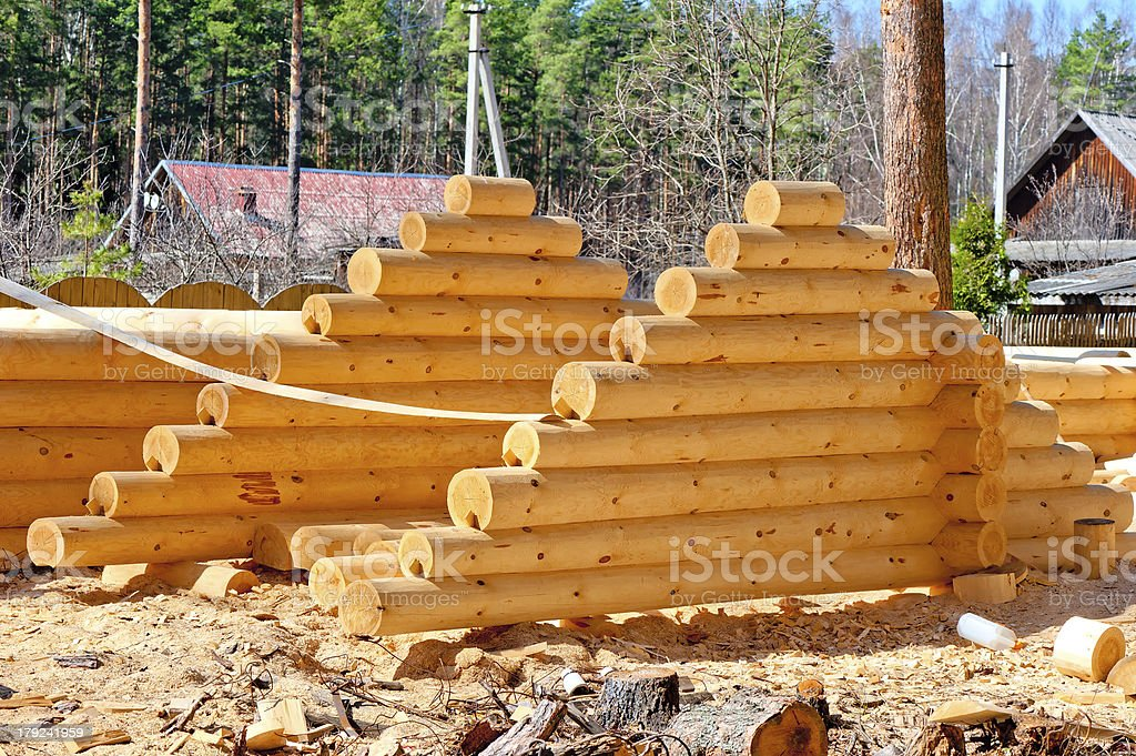 Harvesting roof for log houses from round timber royalty-free stock photo