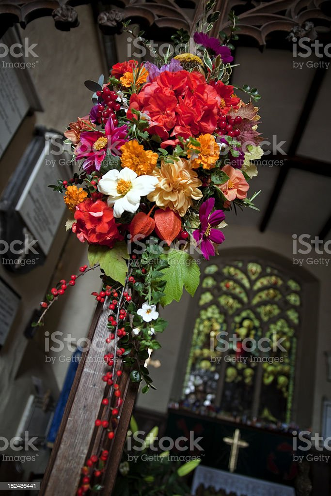 Harvest-time flowers in a church royalty-free stock photo