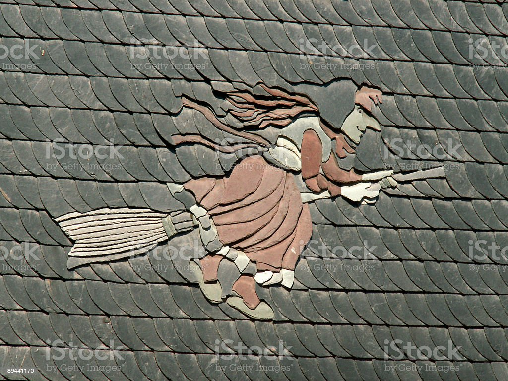 Harzer Hexe an Hauswand in Schiefer stock photo