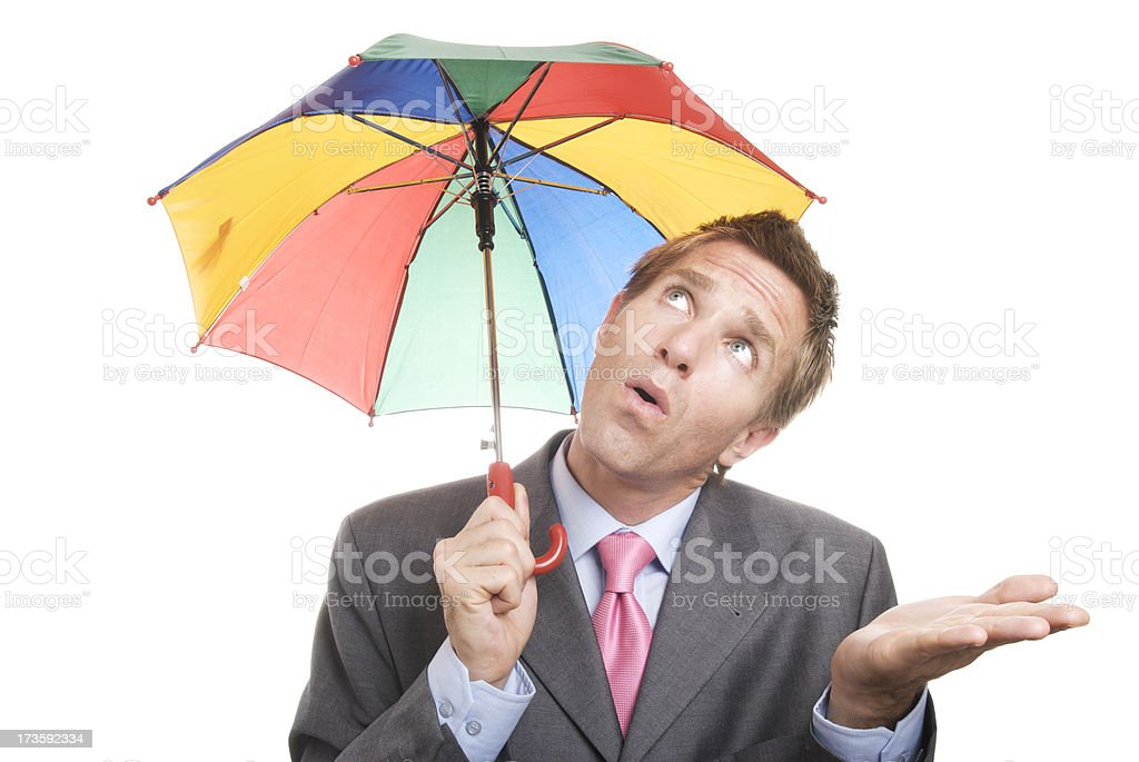 Has the Storm Passed? Businessman Holds Umbrella White Background royalty-free stock photo