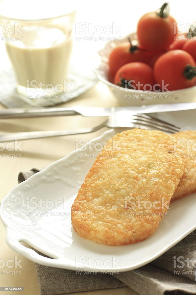 hash brown and tomato royalty-free stock photo