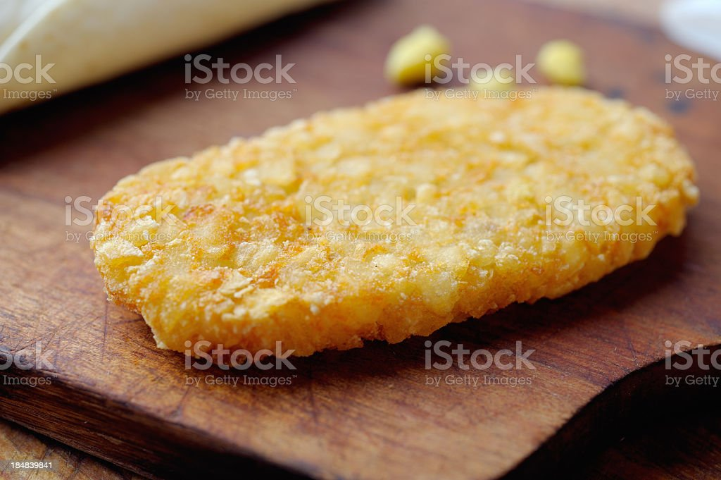 Hash brown on a wooden serving platter stock photo