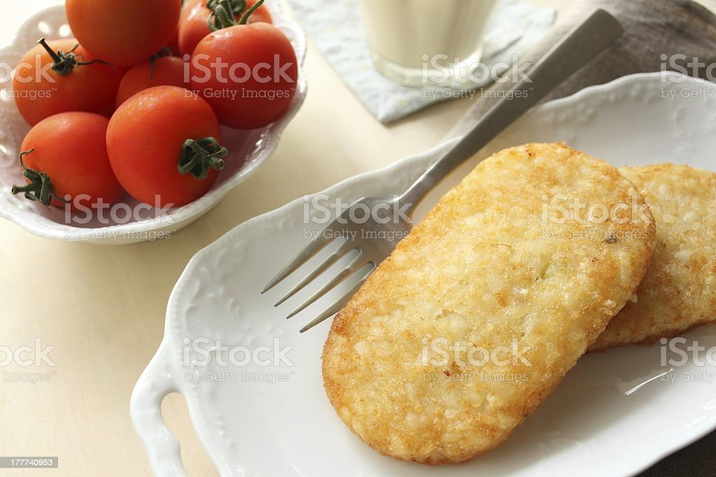hash brown with cherry tomato royalty-free stock photo