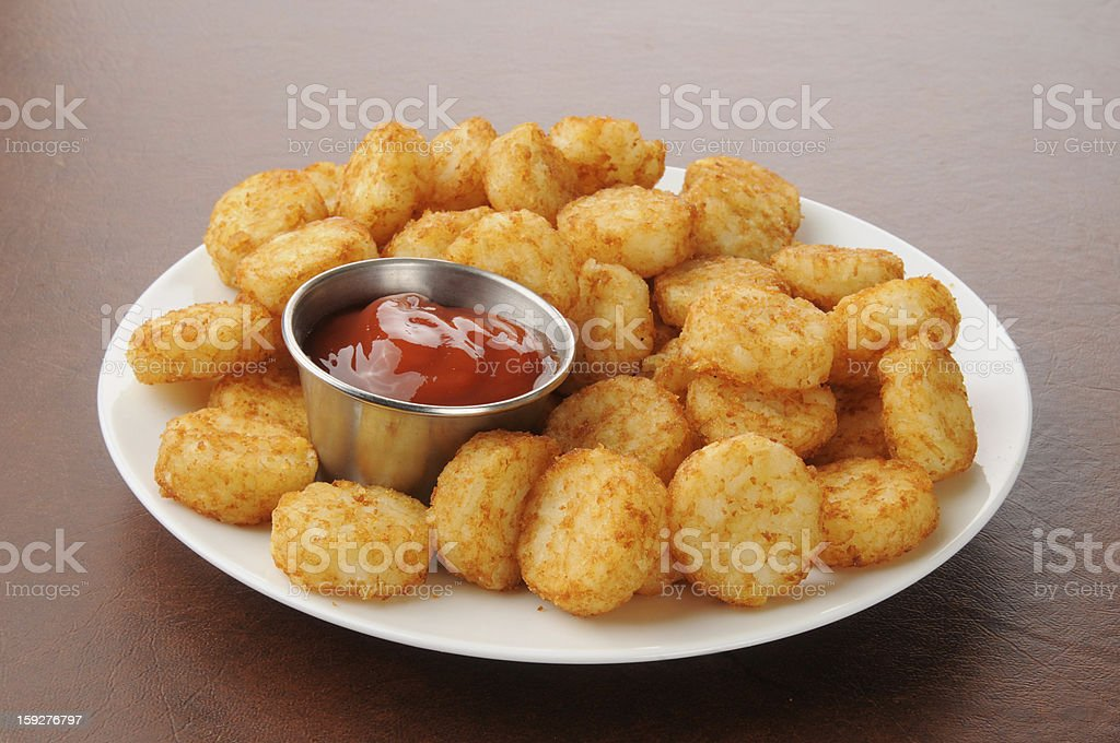 Hash browns and catsup stock photo