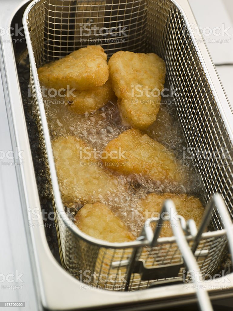 Hash Browns being Deep Fried in Corn Oil royalty-free stock photo
