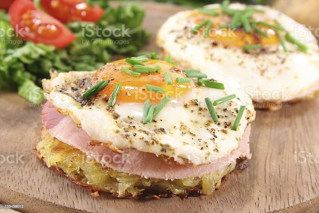 Hash browns with fried egg royalty-free stock photo