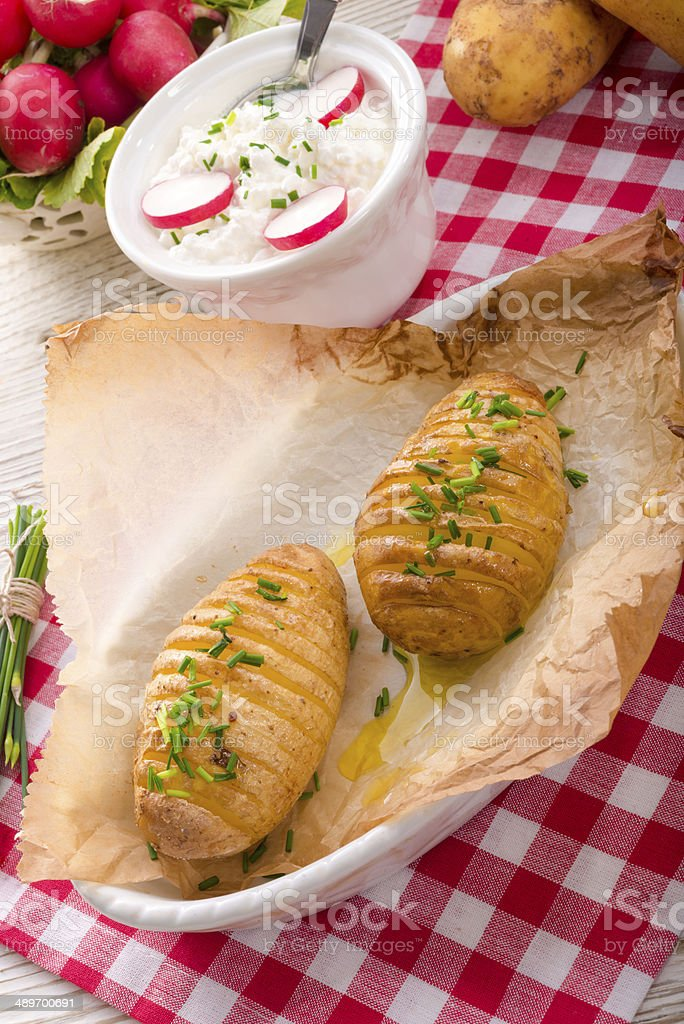 hasselback potato stock photo