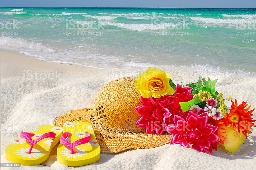 Hat and Flowers on Beach royalty-free stock photo