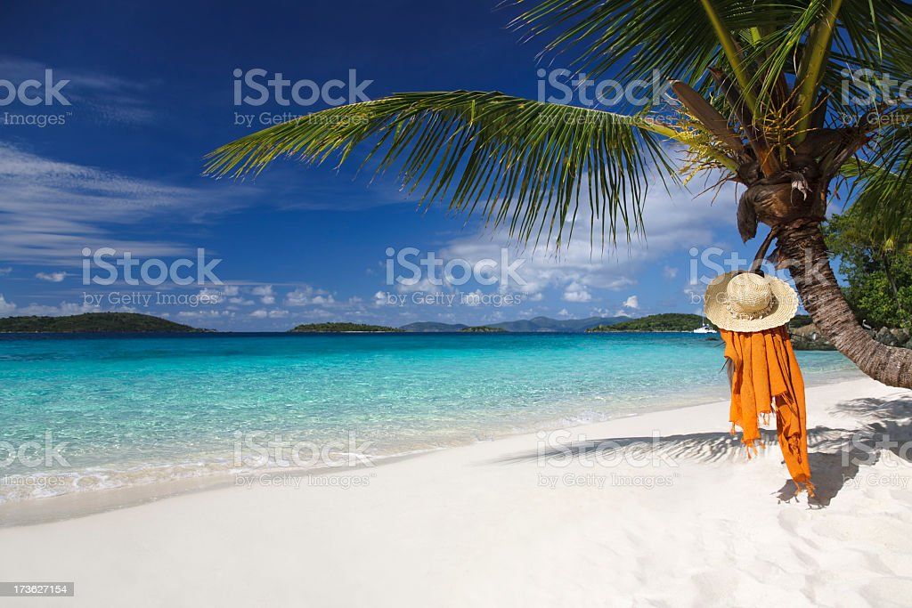 hat and sarong on the Caribbean beach royalty-free stock photo