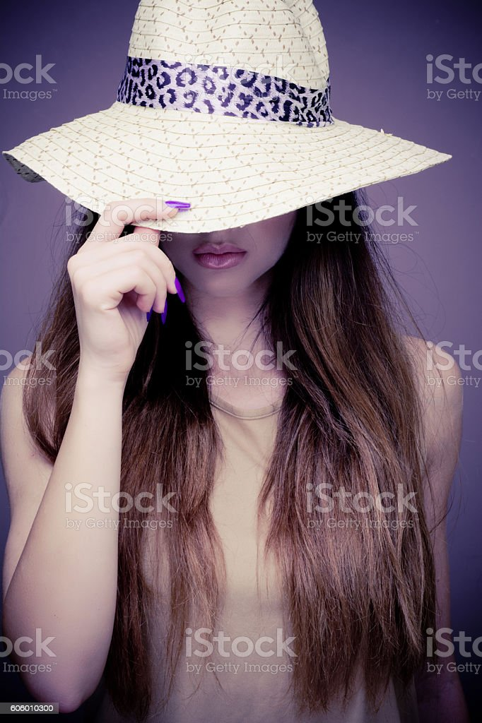 Hat covering female face stock photo