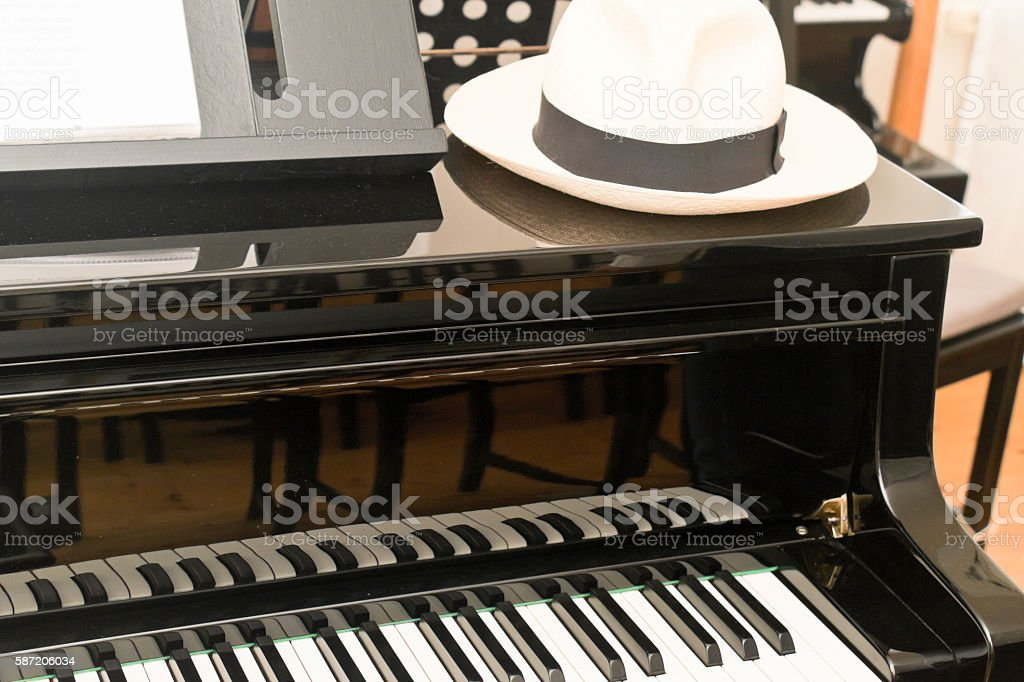 Hat on a piano stock photo