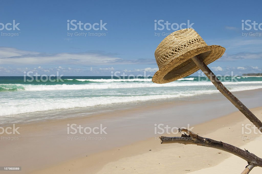 Hat on a stick at Kingscliff beach stock photo