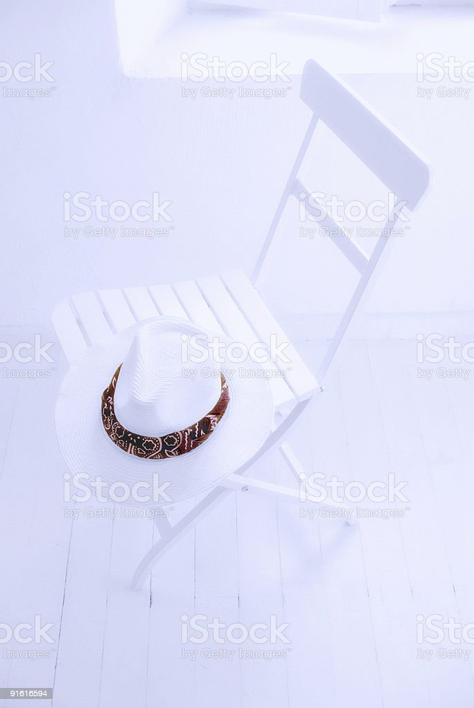 hat on chair stock photo