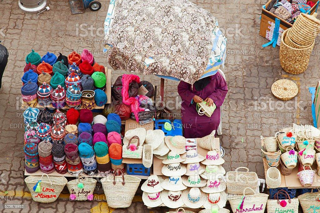 Hat shop in the wicker market inside Marrakech souk. Morocco. stock photo