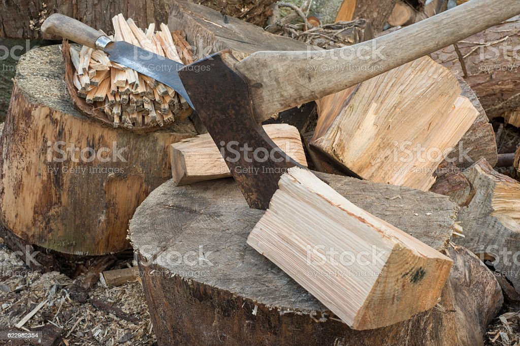 Hatchet by Chunks of Firewood stock photo