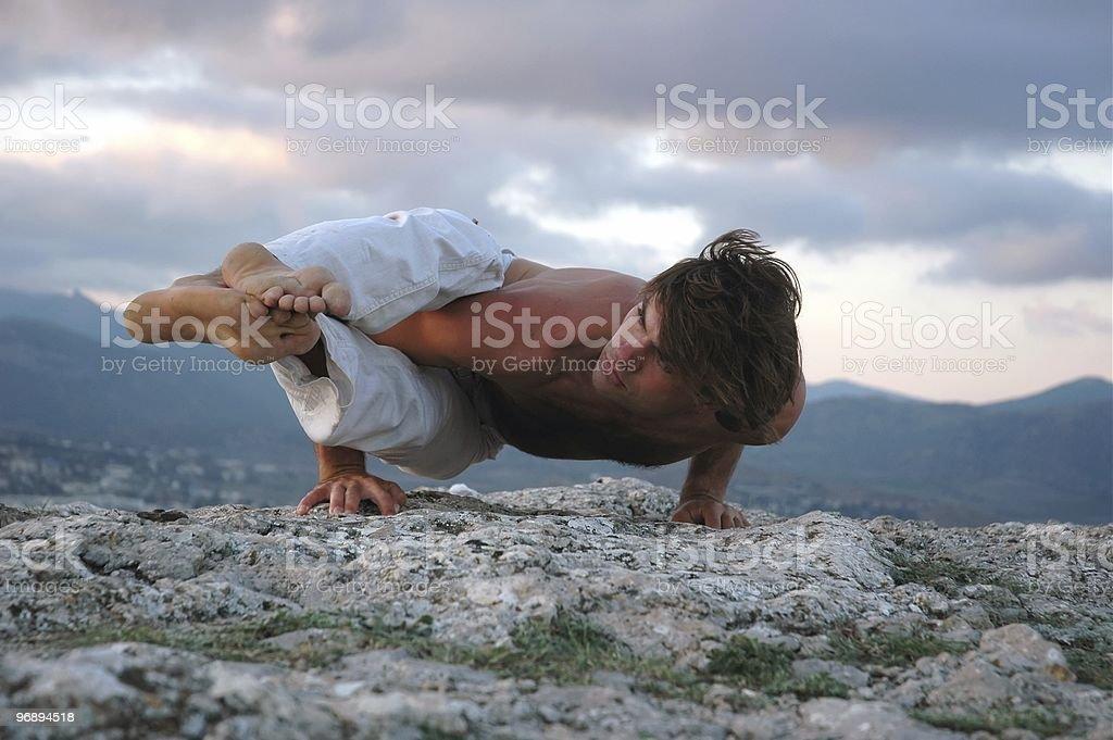 Hatha-yoga: ashtavakrasana. royalty-free stock photo