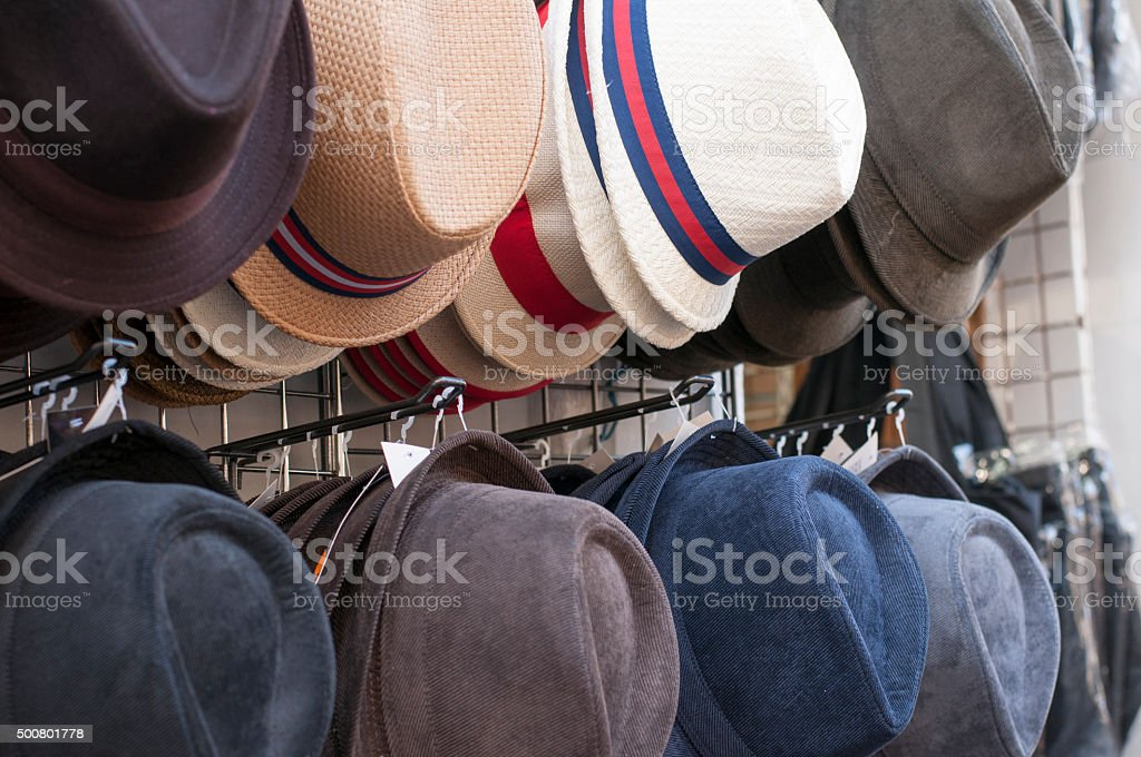 hats for sale hanging from a wall in Paris stock photo
