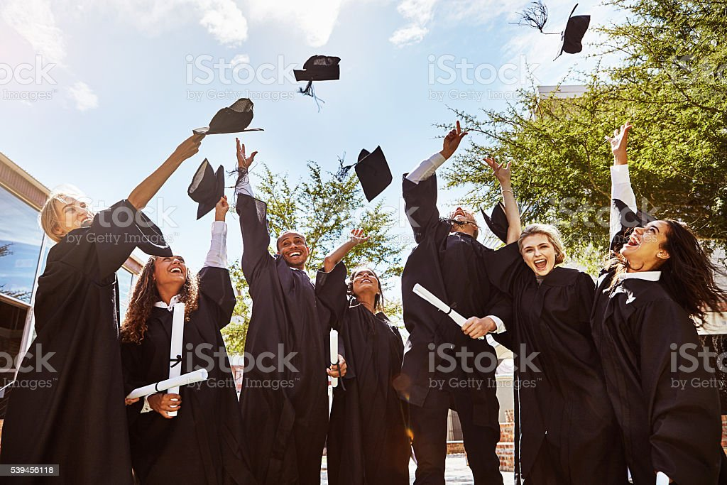 Hats off to graduating! stock photo