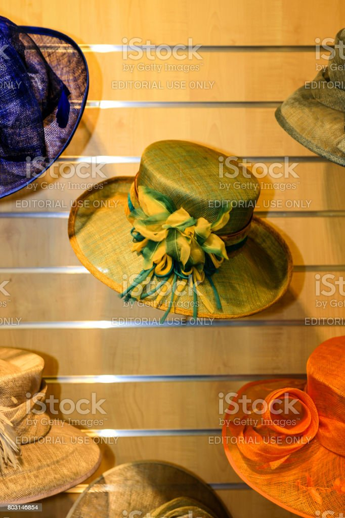 Hats on display at a formal ladies apparel store in Sherborne, Dorset UK stock photo