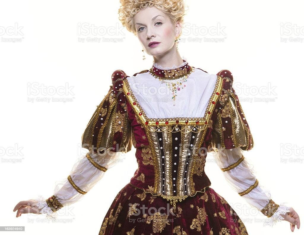 Haughty queen in royal dress isolated on white royalty-free stock photo
