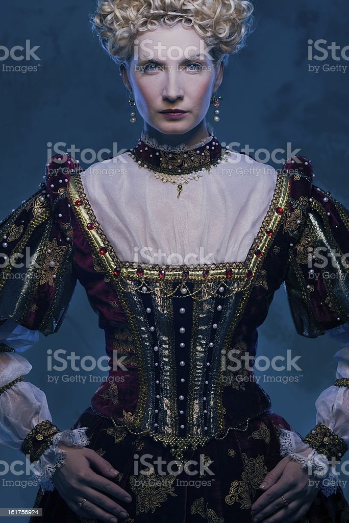 Haughty queen in royal dress royalty-free stock photo
