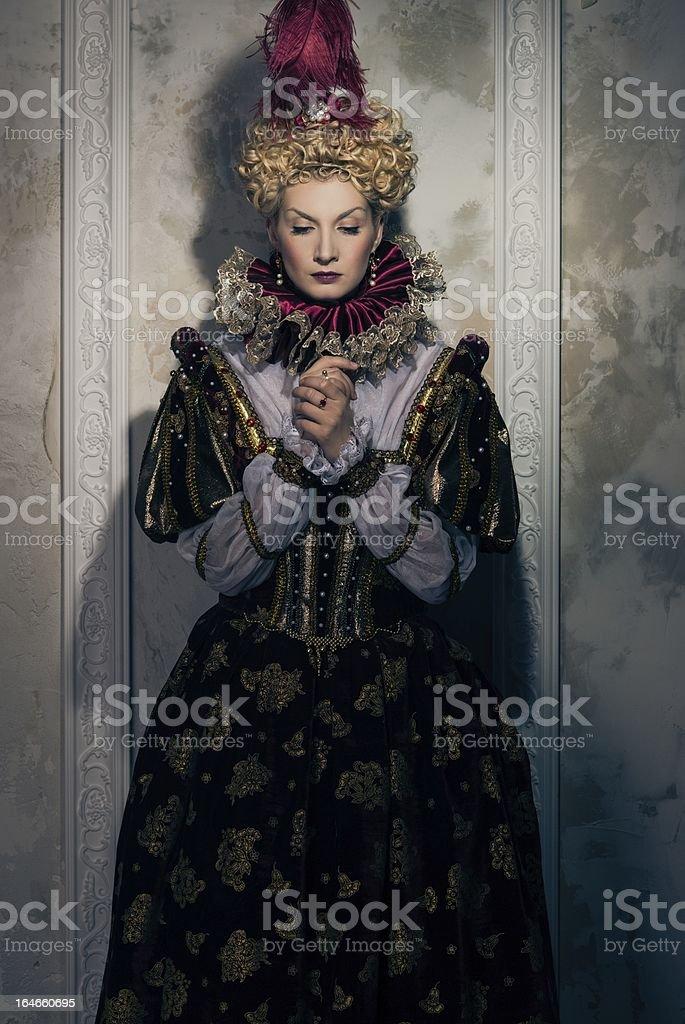 Haughty queen in royal dress stock photo