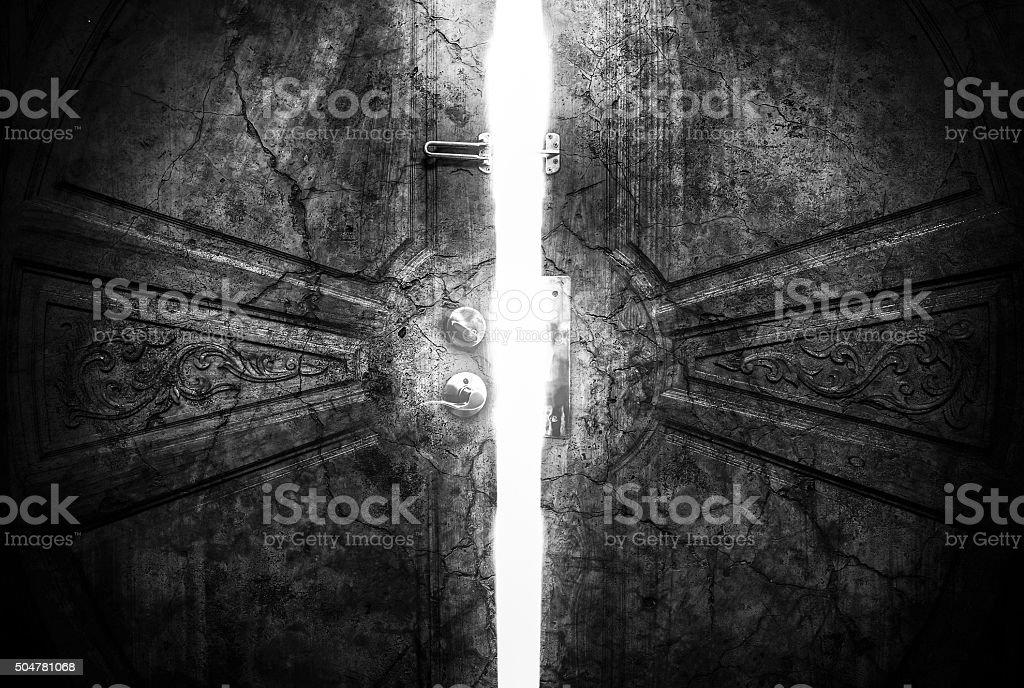 Haunted cracks open the door stock photo