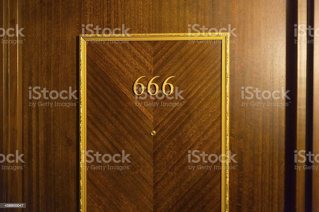 Haunted hotel room door stock photo