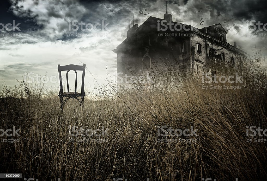 Haunted house and chair stock photo