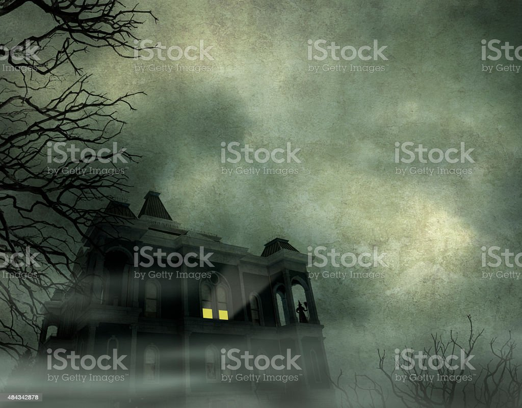Haunted House Framed By Barren Trees stock photo