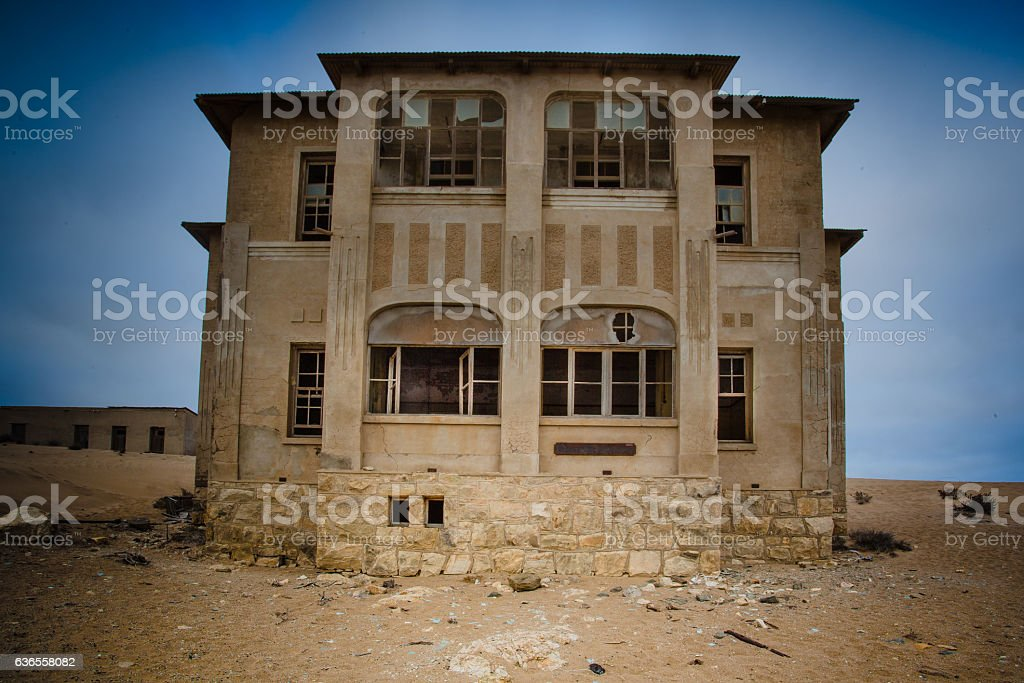 Haunted house in abandoned village in the desert stock photo