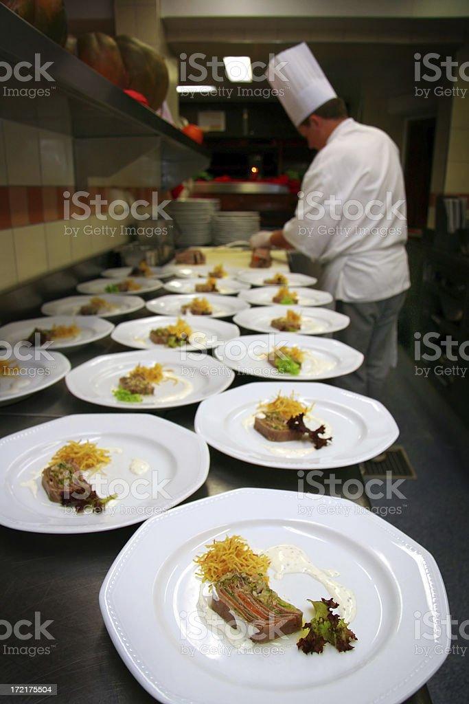 haute cuisine chef preparing  appetizer stock photo