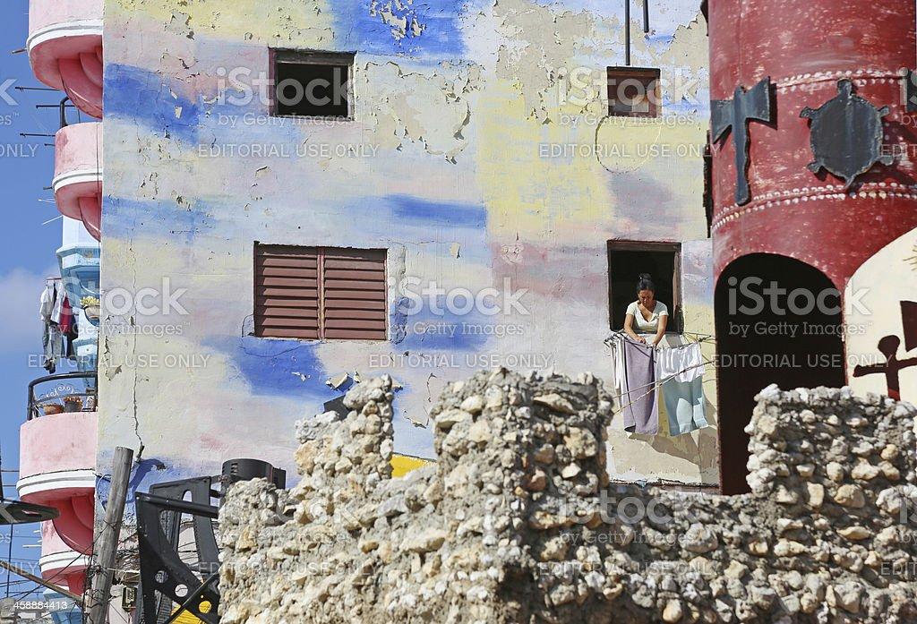 Havana, Cuba Woman hanging laundry in Hamel Alley royalty-free stock photo