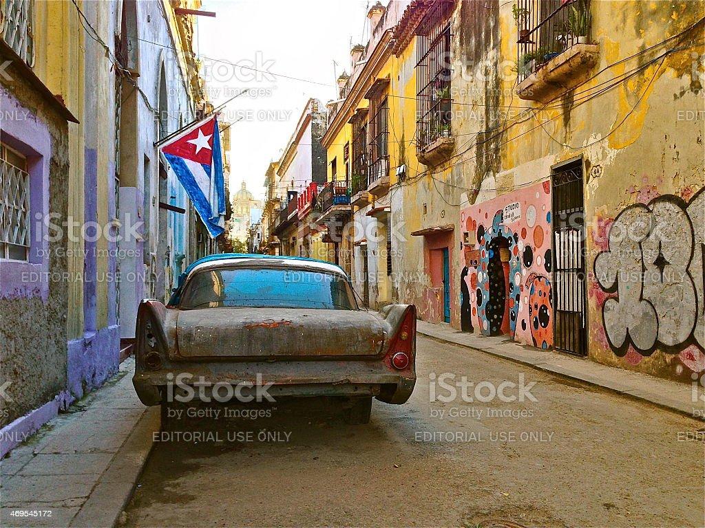 Havana Street with Old Car and Cuban Flag. stock photo