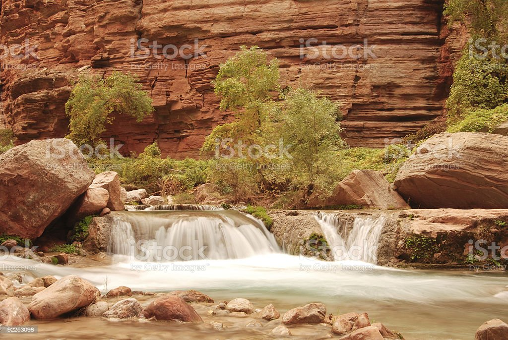 Havasu canyon flowing stream with waterfall, trees and rocks. royalty-free stock photo